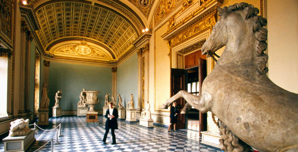 Person inside museum, horse statue to the right